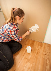Young brunette woman doing house renovation