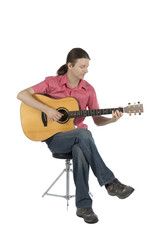 Young guitarist playing acoustic guitar