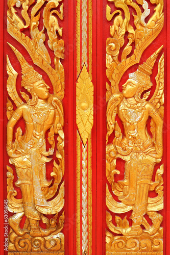 thai golden carving art on the door temple
