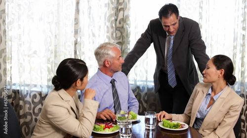 Business associates having a working lunch