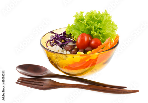 Delicious salad on a bowl with wooden spoon and fork  isolated o