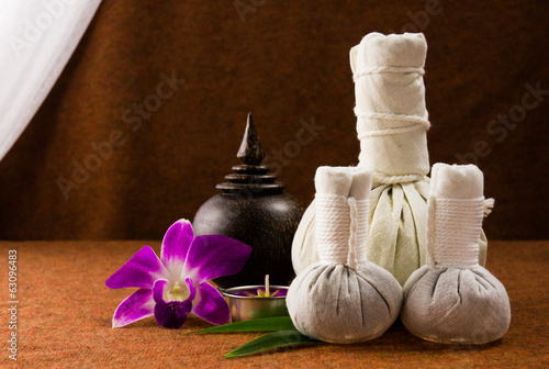 Spa herbal compressing ball with wooden casket and orchid.