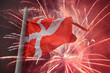 flag of Denmark over fireworks
