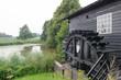 Dutch windmill near the river