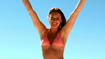 Sexy woman posing and looking at camera on vacation