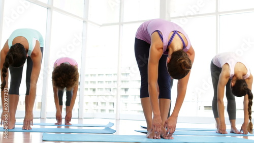 Yoga class warming up in fitness studio
