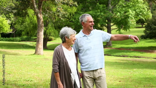 Retired couple walking in the park together