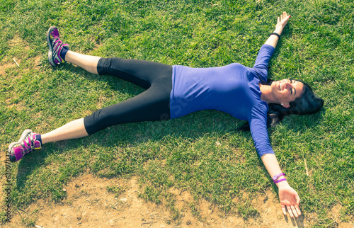 woman gets some rest after long run