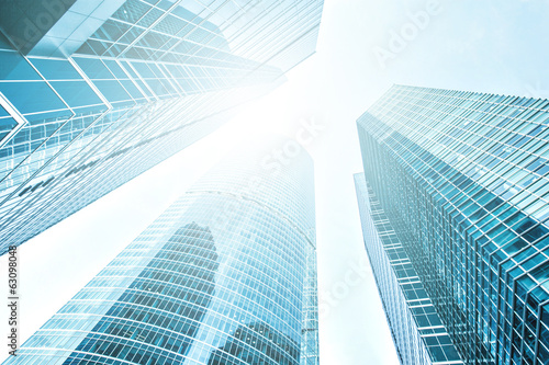 glassy texture of tilt view to contemporary turquoise building