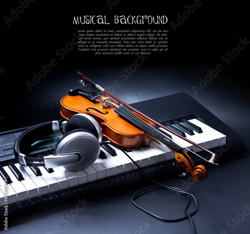 Violin, piano keys and headphones on black
