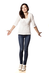 confused girl posing on a white background
