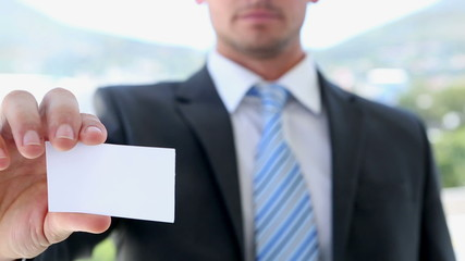 Businessman showing his card