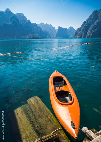 Floating Orange Canoe or Kayak in Rajjaprapha Dam or Ratchapraph