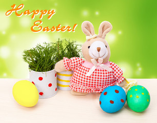 Easter eggs with teddy rabbit and grass