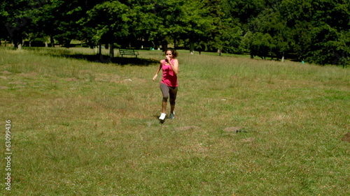 Fit woman sprinting towards camera