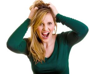 Mädchen greift sich in die Haare und schreit
