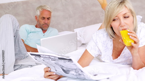 Couple relaxing on bed in the morning