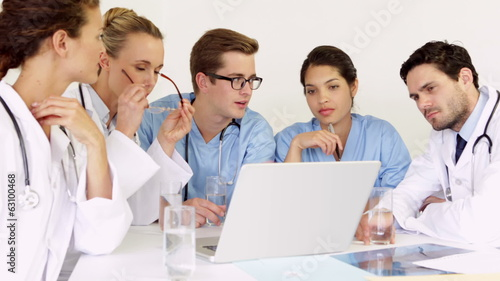 Doctors smiling at camera during a meeting