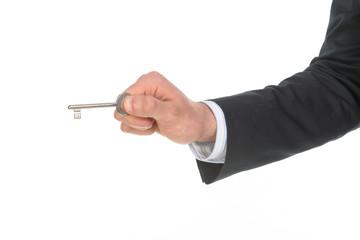 Mano che usa una chiave