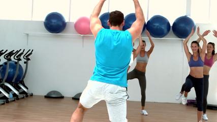 Aerobics class exercising together