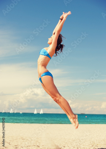 happy jumping woman on the beach