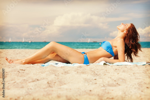 happy smiling woman laying on a towel