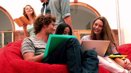 Happy students relaxing in common room