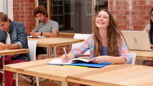 Students sitting in classroom studying