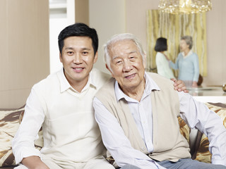 portrait senior father and adult son