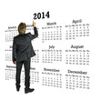 Businessman standing in front of a 2014 calendar