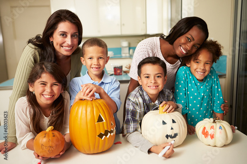 Mothers And Children Making Halloween Lanterns