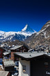 Zermatt town with Matterhorn peak blackground, logo of Toblerone