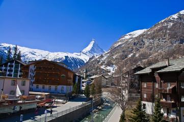 Zermatt town with Matterhorn peak blackground, logo of Toblerone