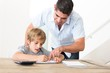 Father assisting son in homework