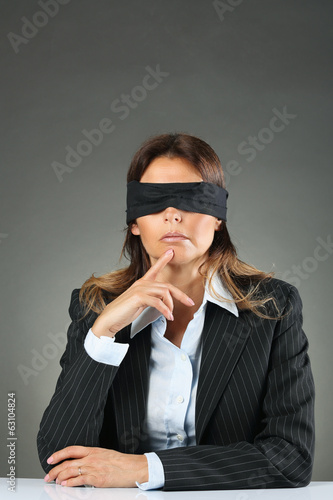 Businesswoman blindfolded