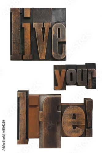live your life phrase written in vintage printing blocks