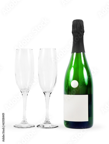 Bottle of champagne and glasses isolated on white