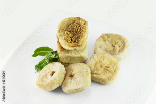 dried figs on a plate with mint leaves