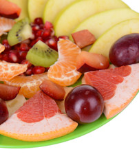 Sweet fresh fruits on plate close-up