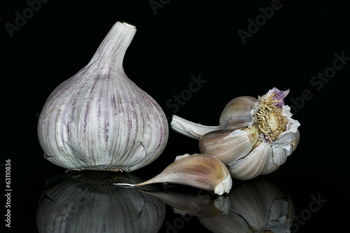 Garlic bulbs, on black background.