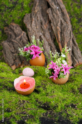Conceptual Easter composition. Burning candle in egg and