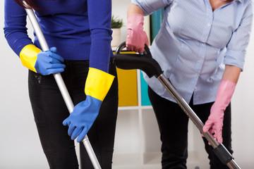 Women during cleaning floor
