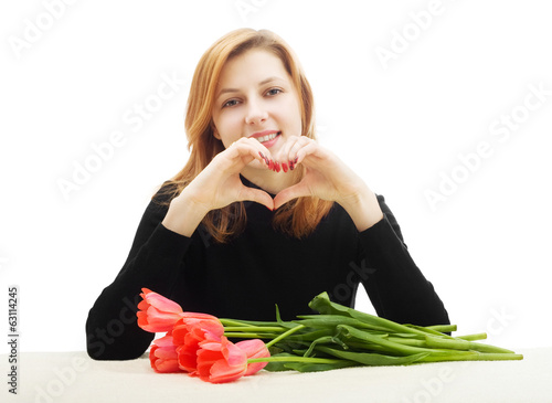 girl showing thumbs up gesture heart