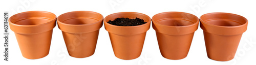 Clay flower pots and soil, isolated on white