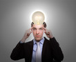 Portrait of young business man thinking with light bulb out from