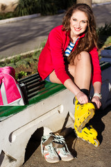 Pretty teenage girl with yellow roller-skates