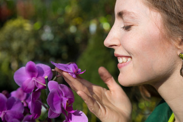 Woman smelling at orchid flower