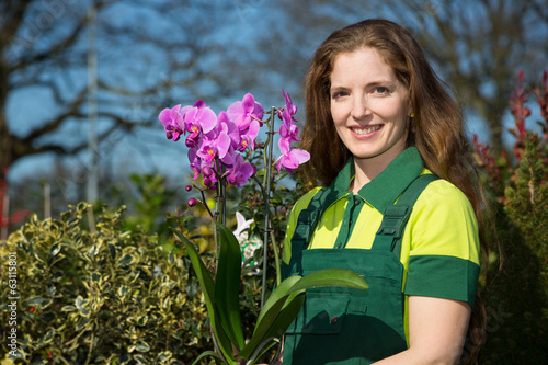 Florist or gardener posing with orchid