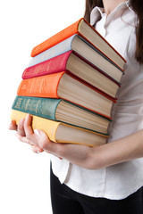 young girl holding a stack of books
