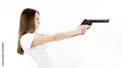 young girl holding a pistol